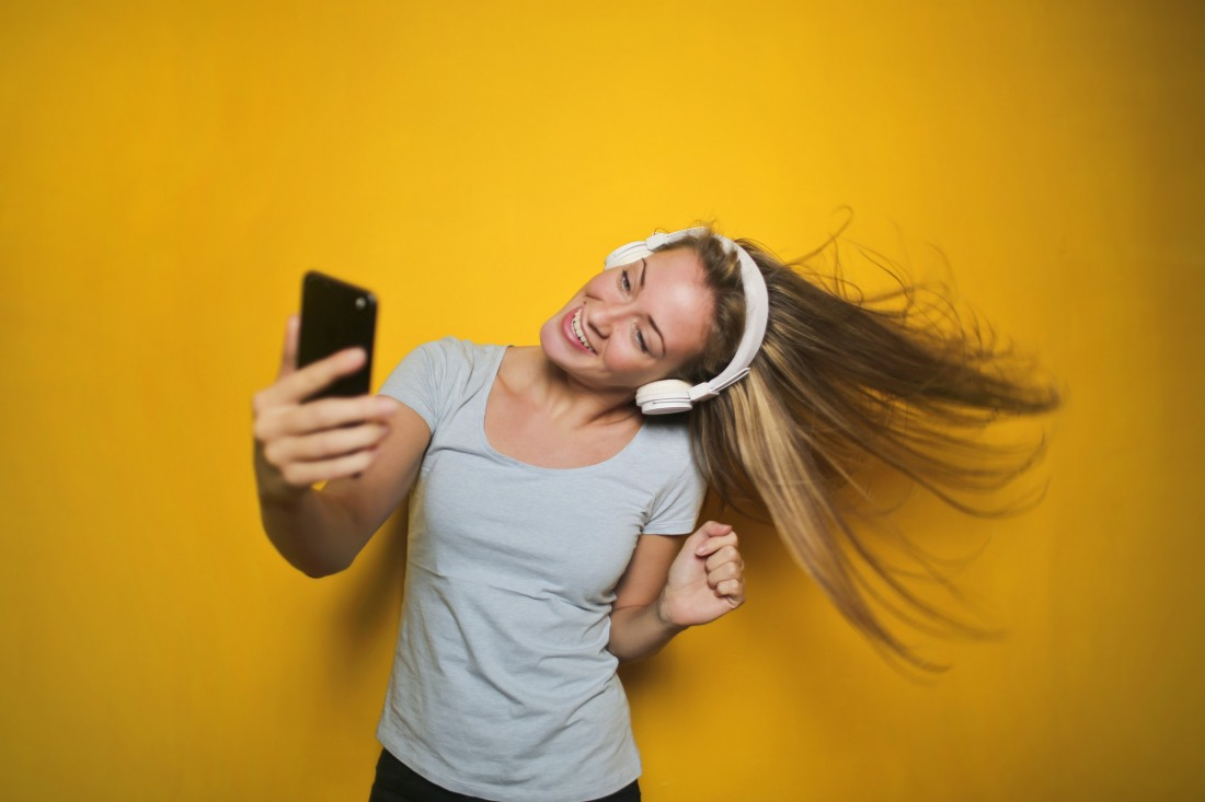 Girl with Headphones (Yellow BG)