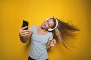 Girl with Headphones (Yellow BG)